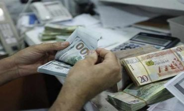 Libya sees currency stabilising next year, squeezing militia